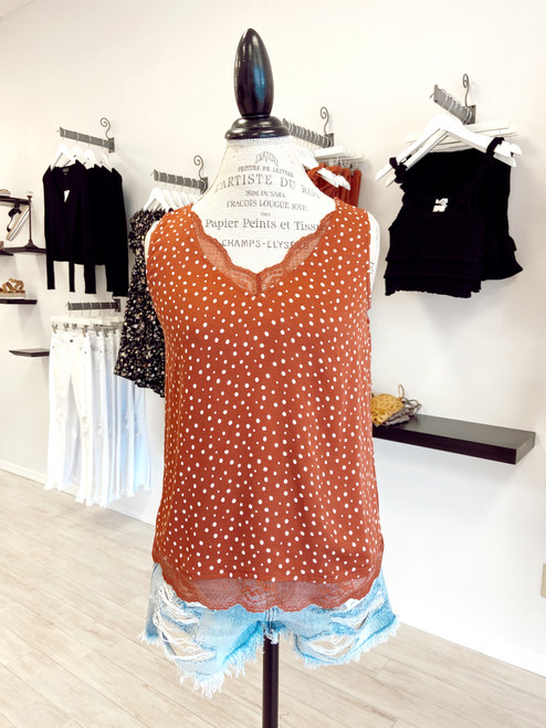 Rust polka dot cami with lace details around neckline and hem