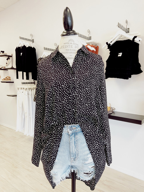 Black and cream high low button down blouse