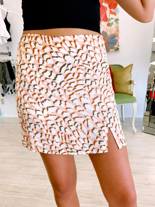 Peach skirt with geometric leopard print