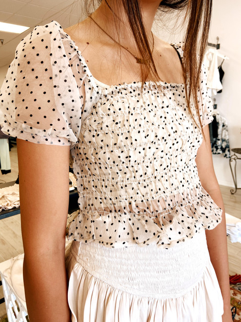 Taupe sheer top with puff sleeves and black polka dots