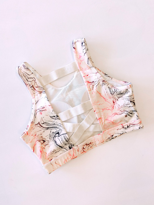 Women's pink and grey marble print sports bra with removable padding
