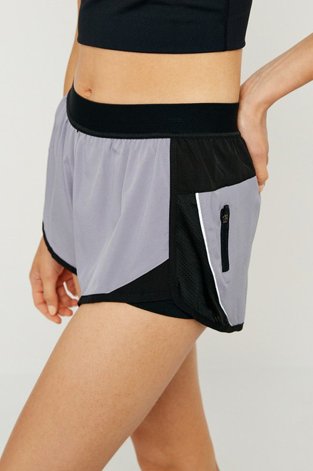 Women's grey active short with compression lining and zipper pocket