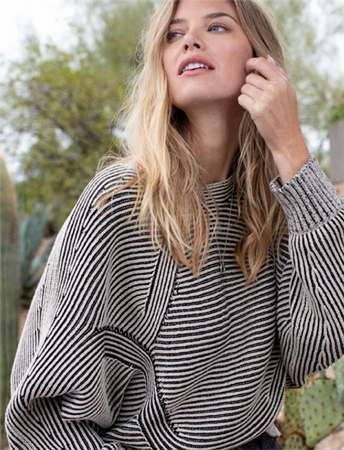 Women's tan and black sweater with dolman sleeve and boat neck