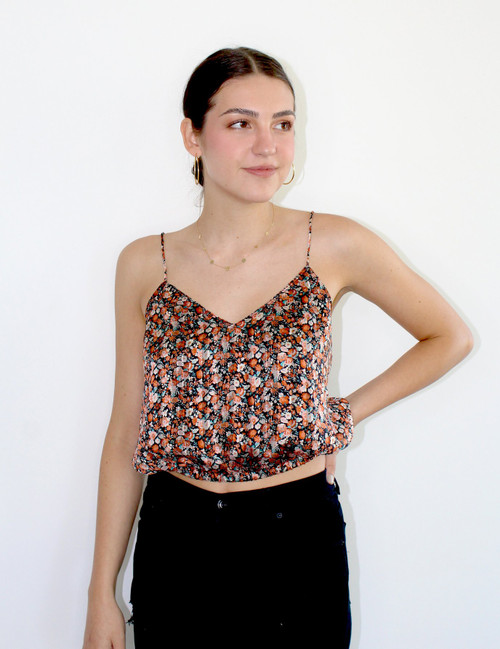 Women's orange and black cropped floral tank top with adjustable straps