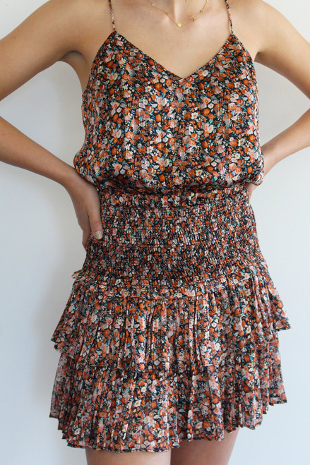 Women's orange and black floral print skirt with smocked waist and double ruffle hem