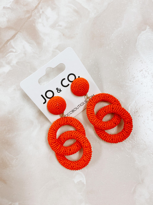 Orange beaded statement earring
