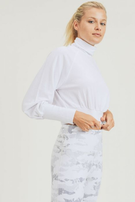 Women's cropped white turtleneck with puffy long sleeve