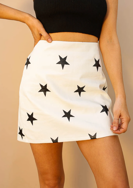 White faux leather skirt with black stars