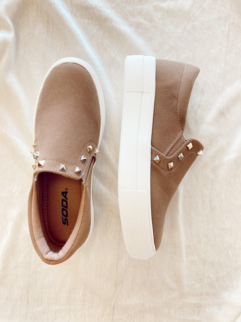 Women's tan slip on sneaker with stud details