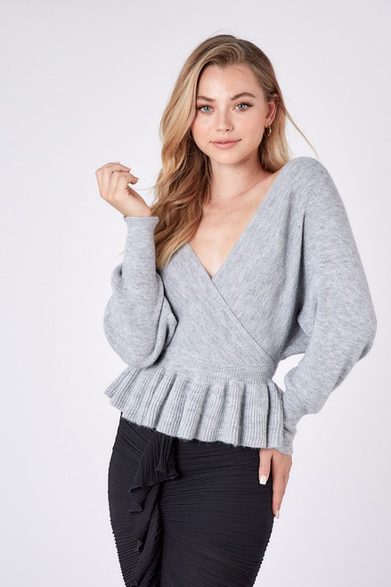 Grey sweater with peplum hem and open back