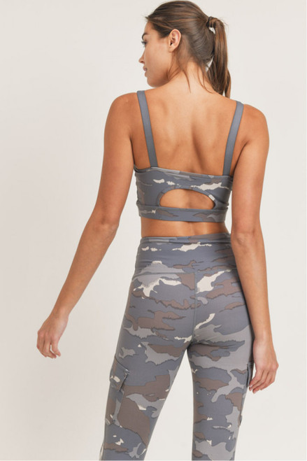 Women's blue camo print sports bra with peekaboo cutout