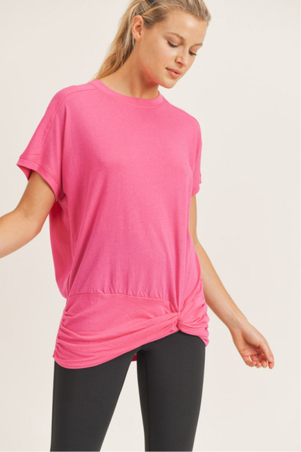 Hot pink tee with twist detail at hem