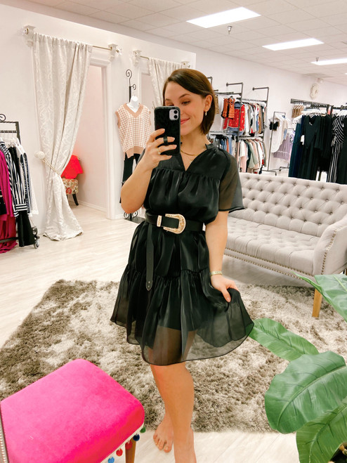 Black babydoll dress with subtle sheen