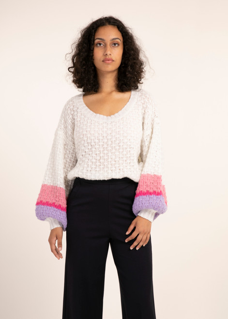 Ivory sweater with pink and purple stripe on sleeve