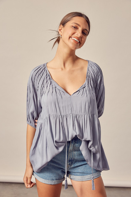 Loose fitting peasant style blouse in white