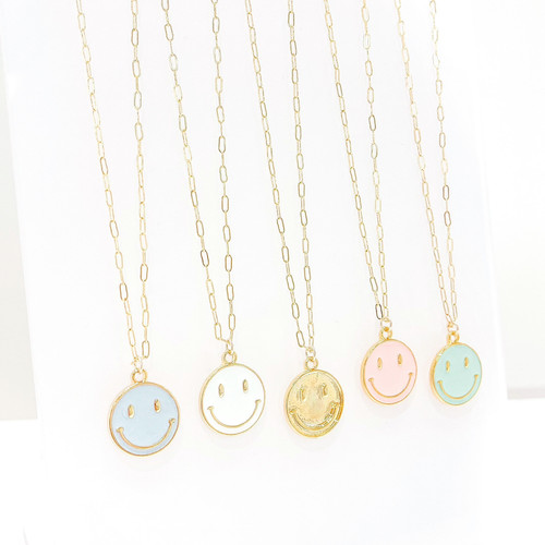 Colorful smiley face necklace on gold chain