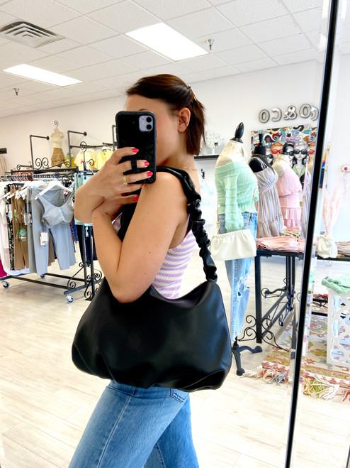 Black shoulder bag with ruched handle