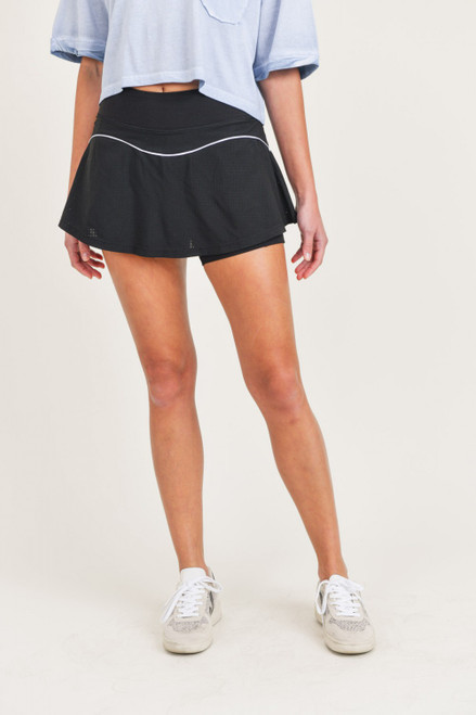 Black tennis skirt with short lining and white contrast detail