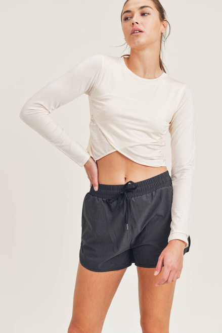Off white long sleeve crop top with overlay detail
