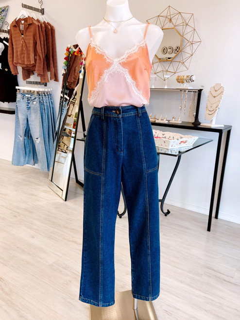 Vintage style dark wash high rise jean with tapered leg