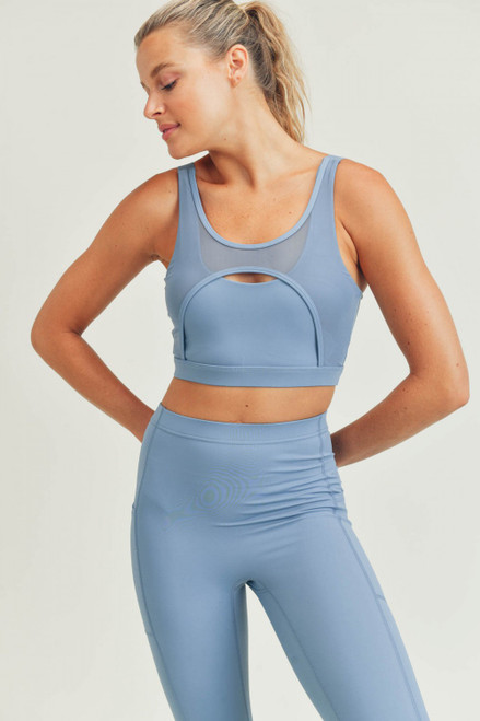 Blue sports bra with mesh details
