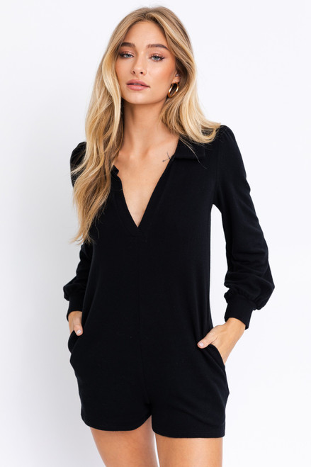 Knit black romper with collar and pockets