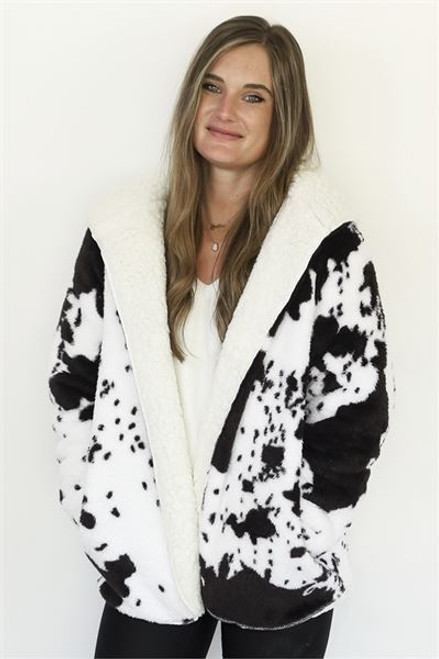 Cow print sherpa lined jacket with hood