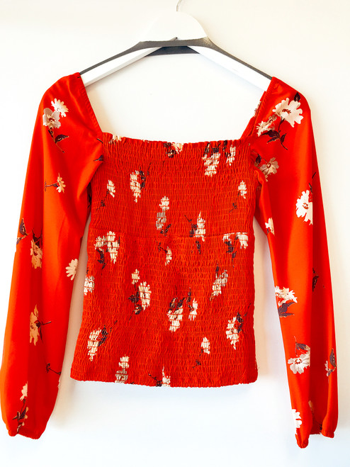 Women's red smocked top with flowy sleeves, trendy smocked top