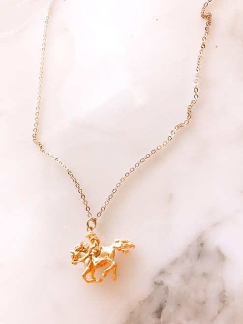 Gold plated cowboy riding horse necklace