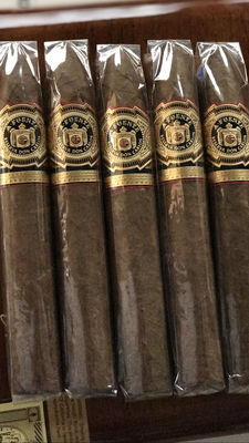 """You will be living in the lap of luxury as soon you light up the Arturo Fuente Don Carlos No. 2 Pyramide. Cocoa and nuts are the dominant flavors that are complimented by cedar and mildly sweet spices . An extraordinary taste experience is one click away  Cigar Aficionado's #6 cigar in the 2013 Top 25 Cigars the Year!  Designed by Don Carlos Fuente for his own personal enjoyment, the Arturo Fuente Don Carlos #2 Cameroon Torpedo (6"""" x 55) has a smooth medium body with a rich, dark African Cameroon wrapper over a vintage Dominican filler. Having both complex and refined flavors in this cigar, gives it a perfect balance of the savory aroma from the delicious Cameroon wrapper. Unquestionably among the world's most elite cigars with its flawless construction, a hallmark of Tabacalera A. Fuente, ensures an even burn and smooth draw. My fellow aficionados will enjoy the beauty of this cigar while enjoying a dark lager and playing a round of 18 off the tea.  everyone else is backordered we got them!!!    5 packs"""
