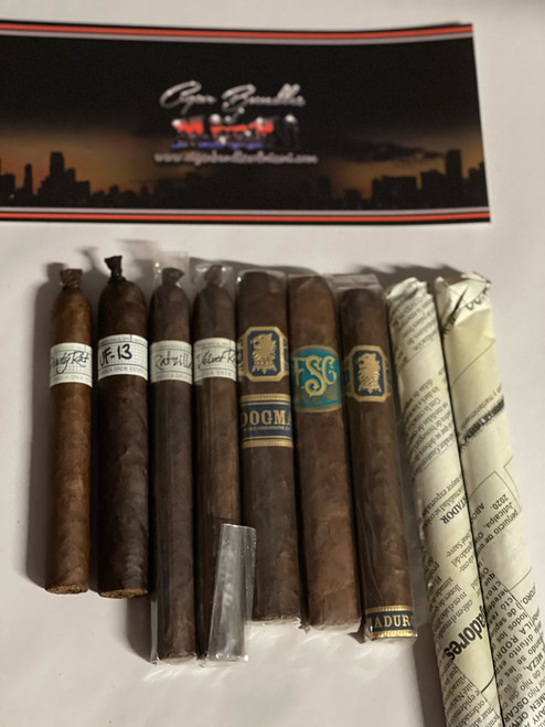 The Dirty Rat Sampler Includes  1 Dirty Rat  1 UF-13  1 Ratzilla  1 Velvet rat   1 Dogma Box Press Maduro  1 Limited Edition FSG Boxpress  1 Under Crown Maduro  3 Rollers Blend Maduro     if you buy 2 i will send you a Box of Manifesto's