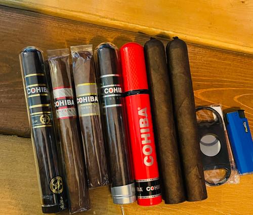 Super Rare Cohiba Weller 1  Cohiba Royale Toro 1  Cohiba Nicaragua 1  Cohiba Black Tubo 1  Cohiba Red Toro Tubo 1  2 Tampa Behike Maduro   1 Single torch  1 Cigar Cutter