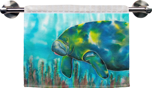 "The Mo the Manatee Ribbed Towel is a soft, high quality towel. Micro denier polyester material makes the towel extra absorbent. The upper part of the towel is ribbed cotton. Dimensions are 16"" x 25""."