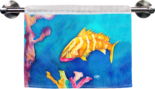"The Tropical Reef Fish Ribbed Towel is a soft, high quality towel. Micro denier polyester material makes the towel extra absorbent. The upper part of the towel is ribbed cotton. Dimensions are 16"" x 25""."