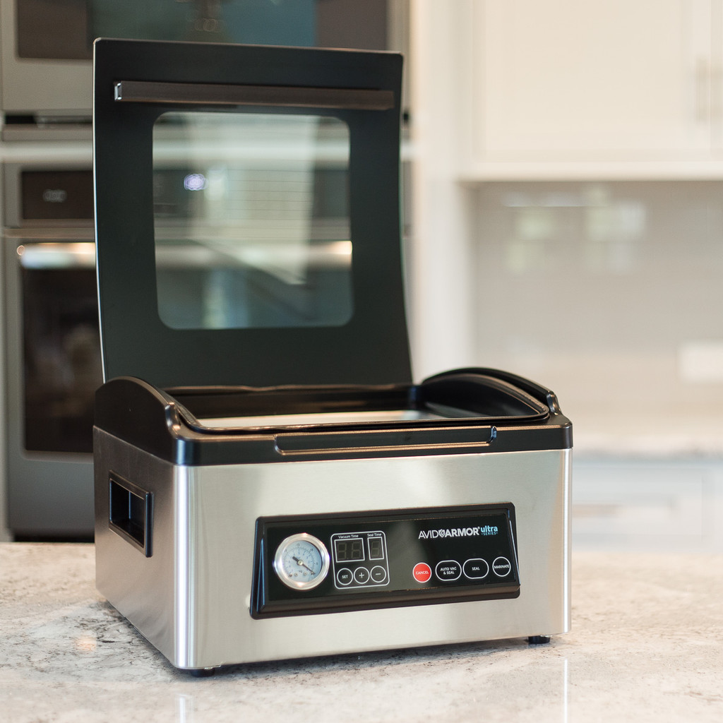 Avid Armor USV32 with clear view glass lid for easy viewing of vacuum and sealing process.