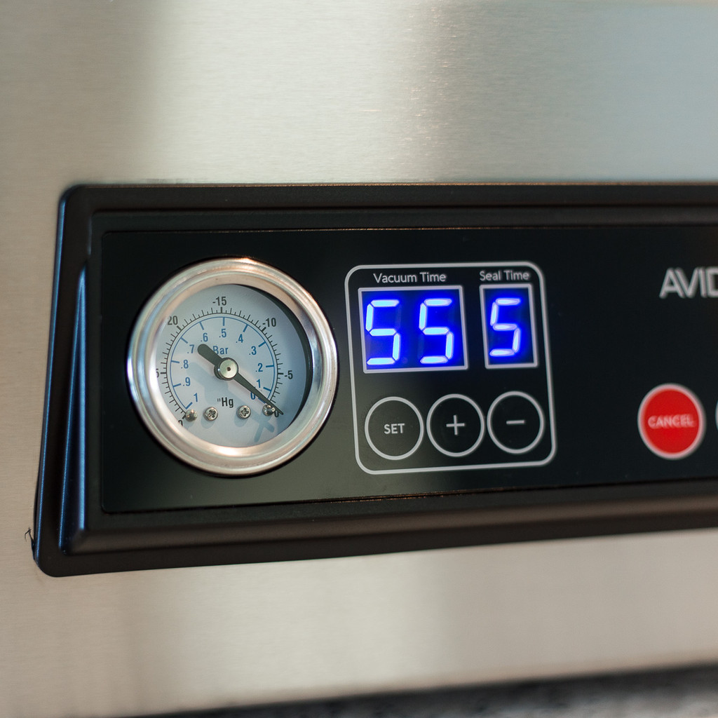 Adjust seal and vacuum times on the Avid Armor USV32 Ultra Series Chamber Sealer