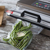 Green beans vacuum sealed in an 8 inch wide vacuum sealer bag for long term freezer storage