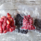 Frozen fruits vacuum sealed in various size food saver bags to preserve freshness and prevent freezer burn.