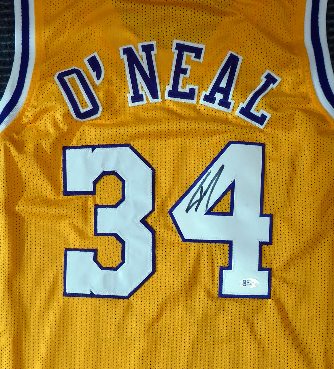 Los Angeles Lakers Shaquille O'Neal Autographed Yellow Jersey On 4 Beckett BAS Stock #191013