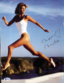"""Christie Brinkley Autographed 10x13 Magazine Page Photo """"Cheers!!"""" Beckett BAS #H10147"""