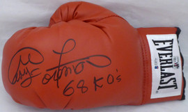 "George Foreman Autographed Red Everlast Boxing Glove LH Signed In Black ""68 KO's"" Beckett BAS Stock #178342"