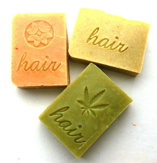 Set of 3 shampoo bars by Aquarian Bath. Orange Lavender, Lemon Vanilla, and Patchouli Hemp pictured