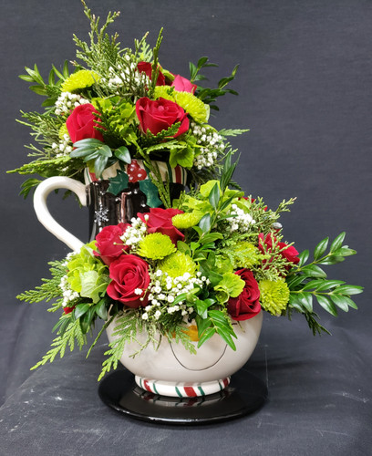 Whimsical arrangement with mug, bowl and saucer set.  Assorted containers including Santas and Snowmen.  Can specify or let us surprise you!  Keepsake and reuseable container.