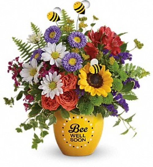 """Boost their spirits and brighten their day with this garden of wellness! Hand-delivered in a sweet ceramic """"Bee Well Soon"""" pot, this colorful arrangement of roses, alstroemeria and asters is abuzz with delightful bee decorations - and your very best wishes for a speedy recovery."""