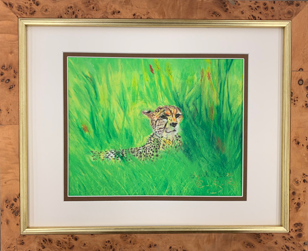 Pastel artwork of a cheetah resting in open grassland.