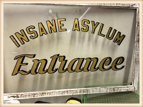 Inside Asylum Entrance Sign