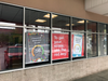 Display banners in retail store windows using Retract Banner System