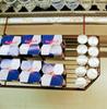 Cooler mount basket holding energy drinks