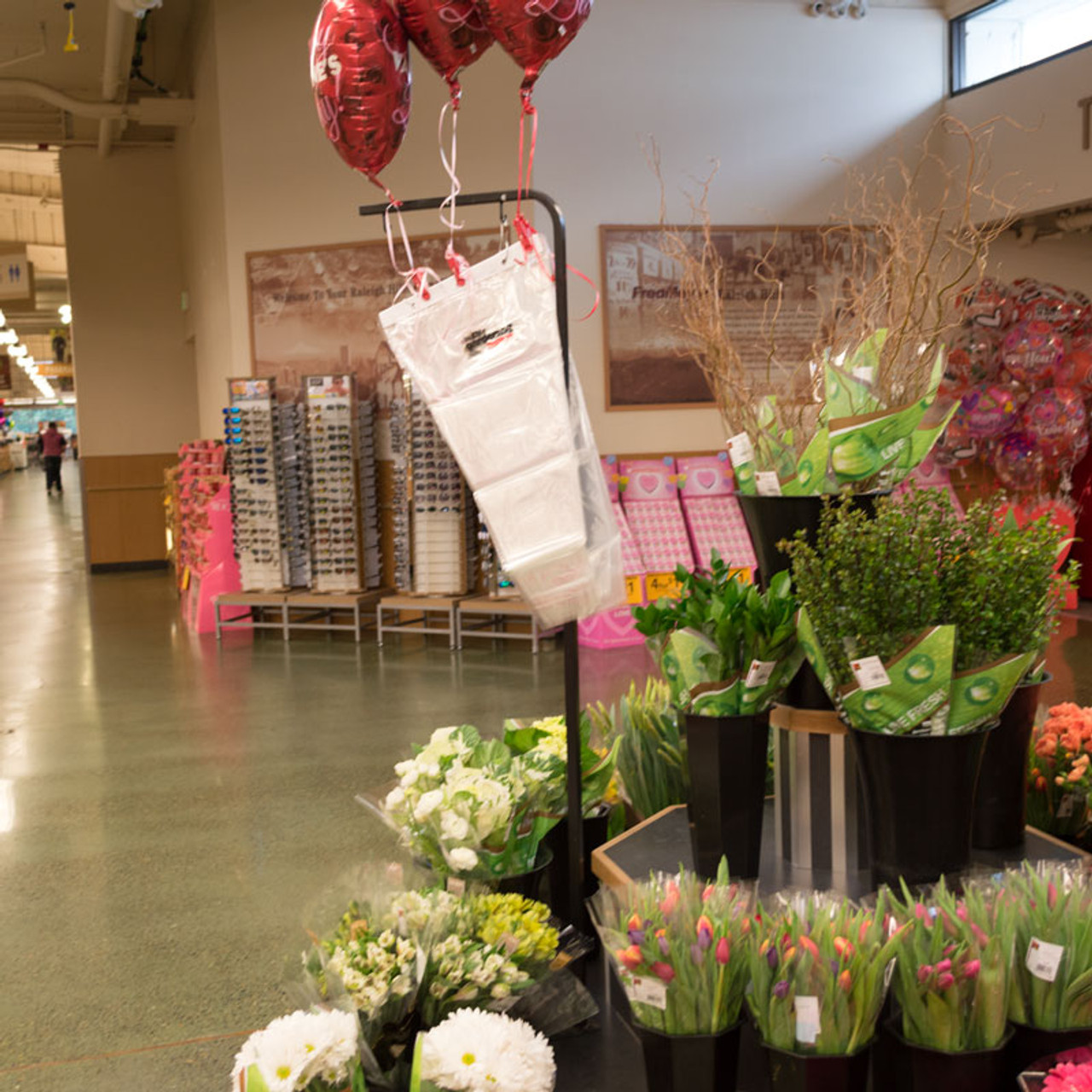 Pallet sign holder being used to dispense bags in floral department