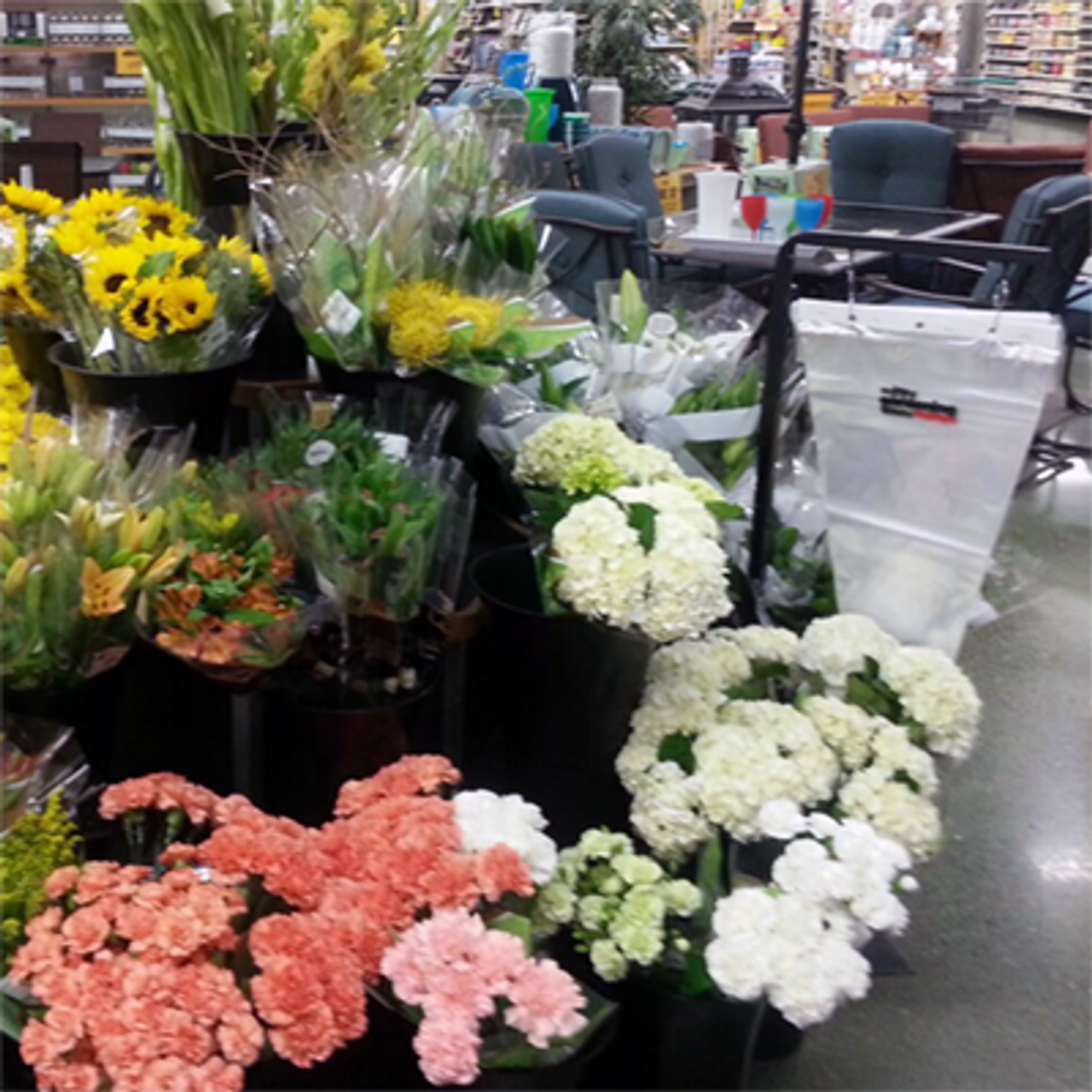 Pallet sign holder being used in floral department